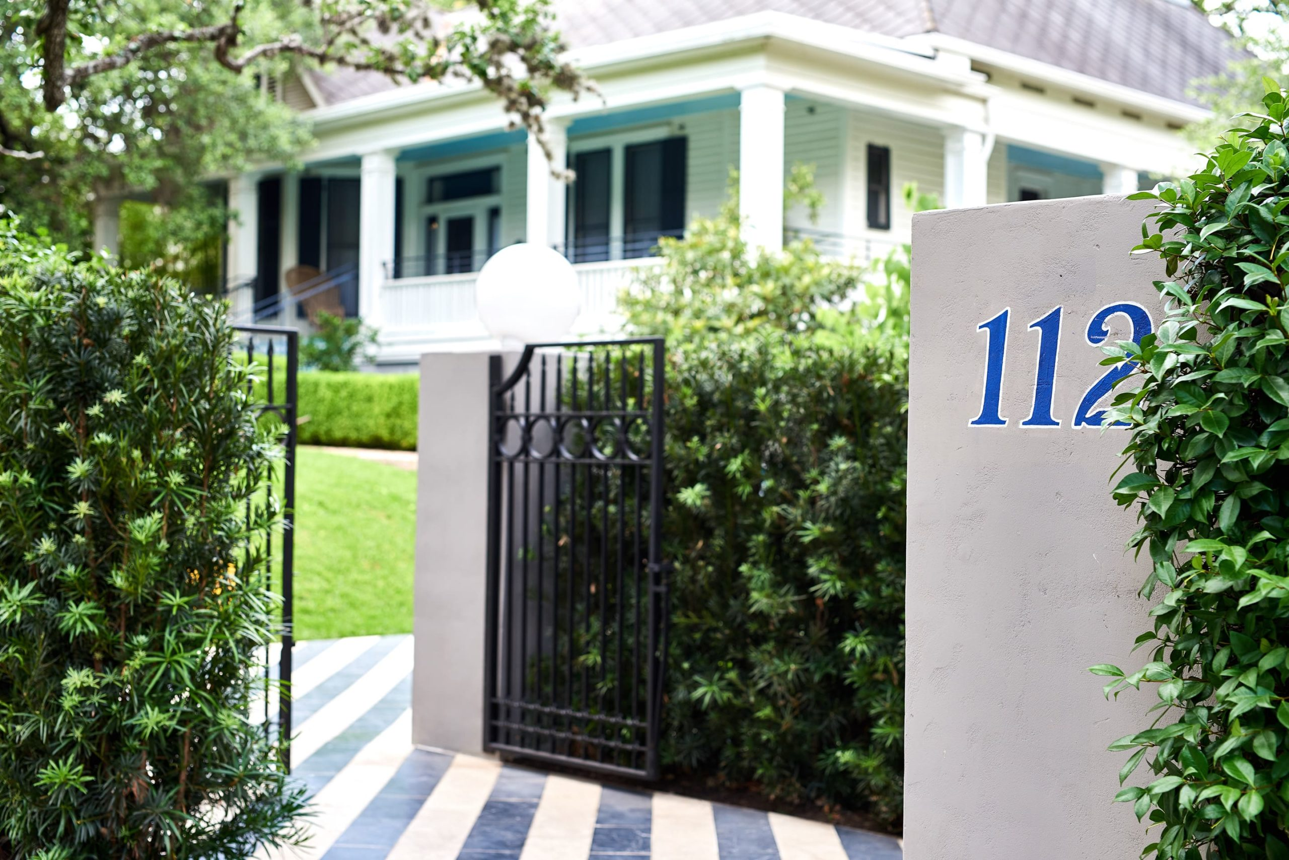 Gate to Hotel Saint Cecilia and a pillar with the street number (112)